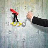 Man carrying red arrow balance on money sign clock hands with an Royalty Free Stock Photo