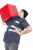 Man carrying red cube Royalty Free Stock Images