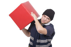 Man carrying red cube Stock Image