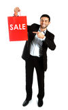 Man carrying a red sale shopping bag royalty free stock photos