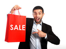 Man carrying a red sale shopping bag stock images
