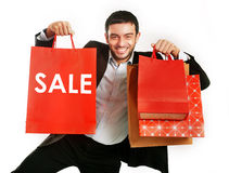 Man carrying red sale shopping bags stock photos
