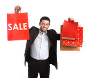Man carrying  red sale shopping bags Stock Image