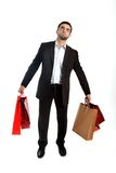 Man carrying sale shopping bags in stress Royalty Free Stock Photo