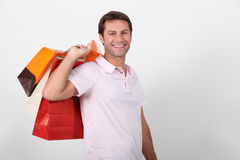 Man carrying shopping bags Royalty Free Stock Images