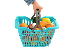 Man carrying a shopping basket full of groceries. Royalty Free Stock Photography