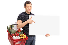 Man carrying a shopping basket and a panel Royalty Free Stock Images