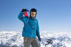 Man carrying ski equipment stock photo