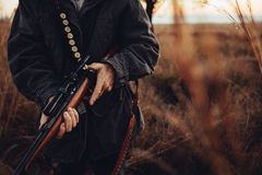 Man carrying sniper and cartridge in wilderness royalty free stock photos