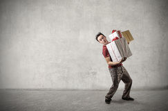 Man carrying some presents Stock Photos