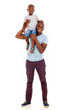 Man carrying son. Cheerful young african american men carrying son on his shoulder Stock Images