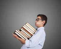 Man carrying stack of books Royalty Free Stock Photos