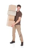 Man carrying stack of boxes Royalty Free Stock Image