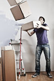 Man Carrying Stacked Boxes Royalty Free Stock Photography