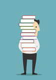 Man is carrying a tall pile of books Royalty Free Stock Photos