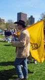 Man Carrying Tea Party Flag. Man at a Tea Party Rally carrying a Don't Tread on Me flag Stock Photo