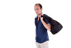 Man carrying a travel bag Stock Images
