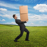 Man carrying two heavy boxes Stock Images