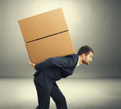Man carrying two heavy boxes Stock Image