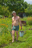 Man carrying water 10. The gardener is carrying a water with buckets Royalty Free Stock Photo