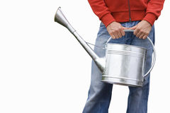 Man carrying watering can, front view, mid-section, cut out Royalty Free Stock Image
