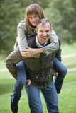 Man carrying woman Royalty Free Stock Images