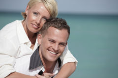 Man carrying with woman Royalty Free Stock Image