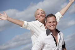 Man carrying with woman Stock Image