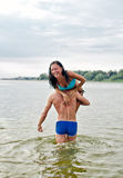 Man carrying woman Royalty Free Stock Photography