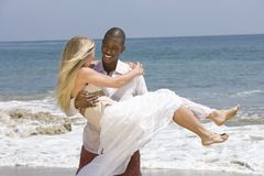 Man Carrying Woman At Beach Stock Images