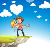 Man carrying woman on the cliff Royalty Free Stock Photo