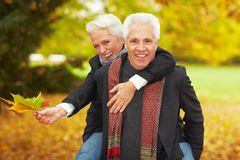 Man carrying woman on his back Royalty Free Stock Photo
