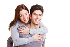 Man carrying woman on his back Stock Photos