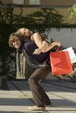 A man carrying a woman on his back. Royalty Free Stock Images