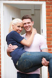 Man Carrying Woman Over Threshold Of New Home Stock Photos
