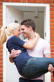Man Carrying Woman Over Threshold Of New Home Royalty Free Stock Photo