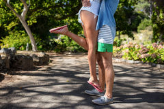 Man carrying woman in park Royalty Free Stock Image