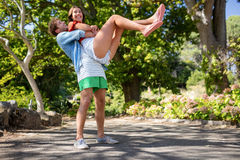 Man carrying woman in park Royalty Free Stock Photo