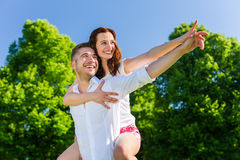 Man carrying woman in park Royalty Free Stock Photography