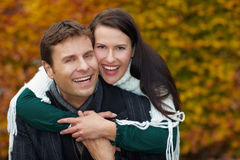 Man carrying woman piggyback Royalty Free Stock Photo