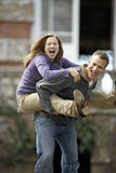 Man carrying woman by piggyback, smiling, portrait Stock Photo