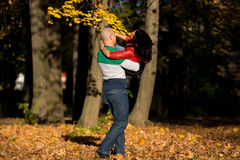 Man Carrying Woman Ride Through Autumn Woods Royalty Free Stock Photo