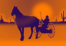 Man in cart in desert Stock Images