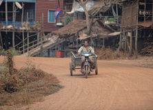 Man with cart, Tonle Sap, Cambodia Royalty Free Stock Images