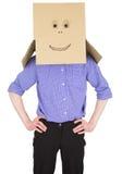 Man with carton box instead of head Royalty Free Stock Photos