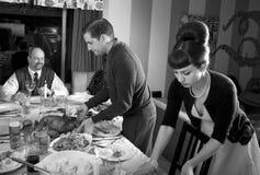 Retro Family Thanksgiving Day Dinner Turkey Carving. Man carves Thanksgiving dinner turkey stock photo