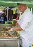 Man carving beef meat. LEEK STAFFORDSHIRE ENGLAND - 26th July 2014 - Leek & District Show Stock Photo