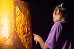 Man carving the big candle in thailand Royalty Free Stock Image