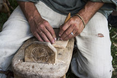 Man carving Stock Images