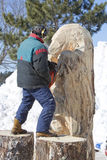 Man Carving Huge Bear from Log with Chainsaw Close Up Royalty Free Stock Photos